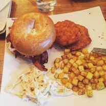 The streaky bacon Boston bagel, home fries, slaw, and extra hash browns